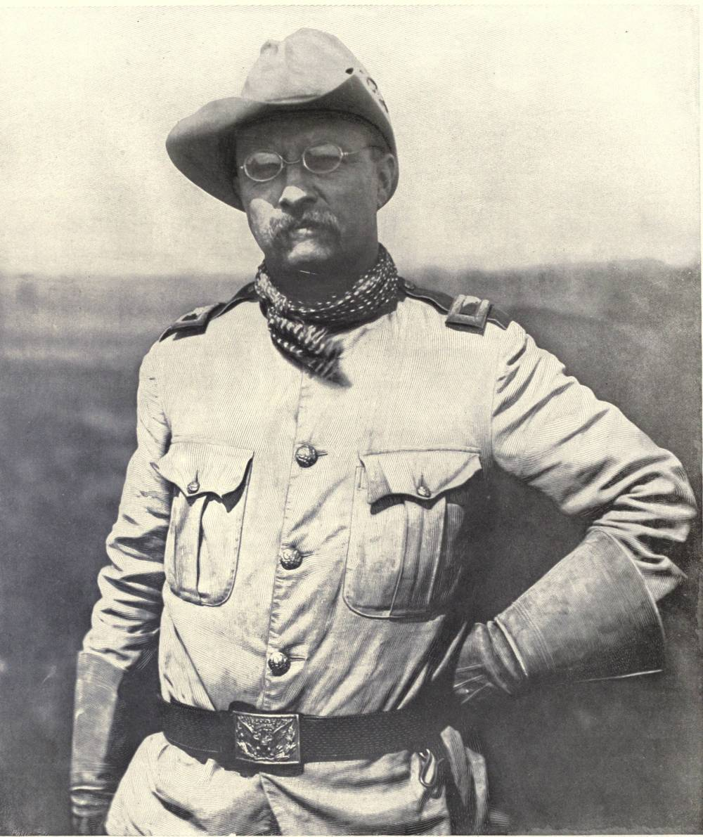 Theodore_Roosevelt_in_Rough_Rider_uniform_in_the_field.jpg